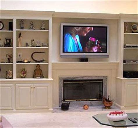 fireplace with bookcase custom made bookcases and fireplace with plasma tv by artisan custom bookcases custommade