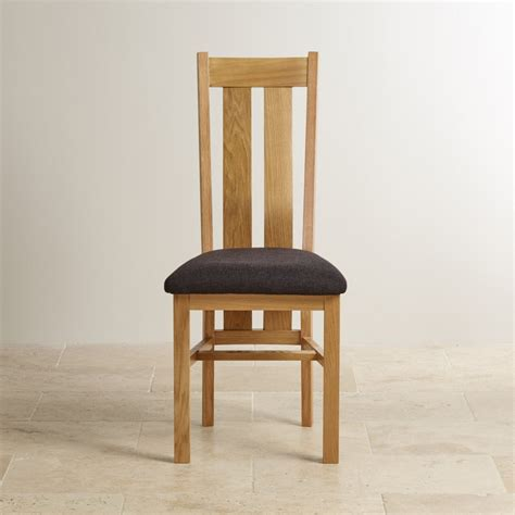 arched back solid oak dining chair in plain black