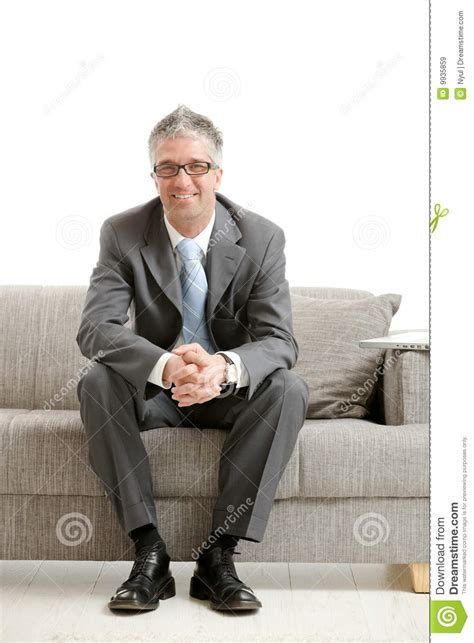 sitting on couch businessman sitting on couch royalty free stock images