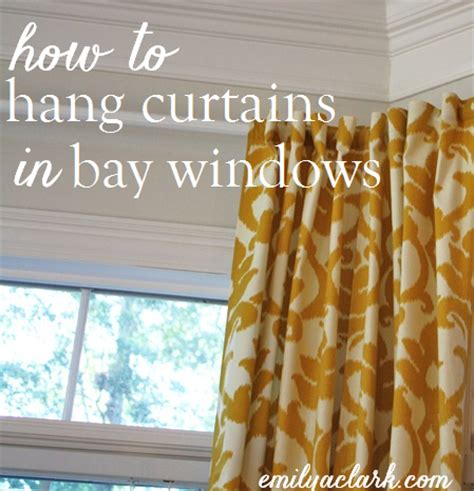 how to put curtains on bay windows hanging curtains on angled windows emily a clark