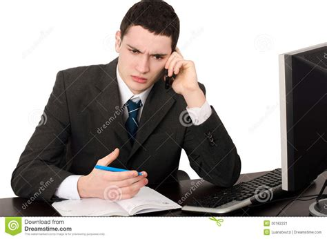 business man sitting  desk talking   phone stock image image
