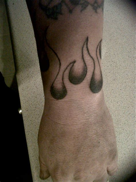 all around wrist tattoos flames around wrist done by allen by jones tattoos