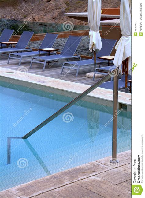 Pool Deck Lounge Chairs by Pool Patio Lounge Chairs Stock Photo Cartoondealer 23350392