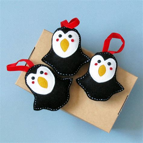 three percival penguin christmas decorations by