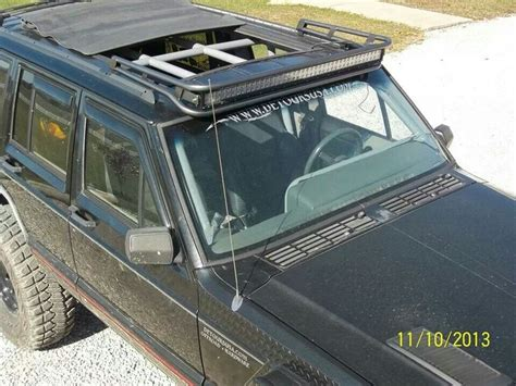 jeep xj sunroof roll back sun roof with an awesome light bar jeep xj