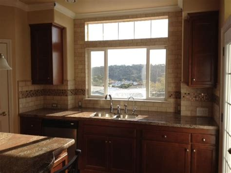 tile around kitchen window crema bordeaux granite kitchen countertops in grover beach
