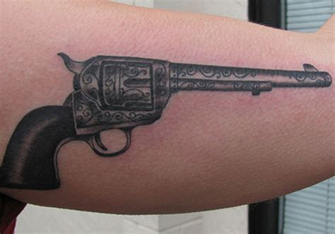 tattoo pictures of guns awesome gray pistol tattoo on bicep