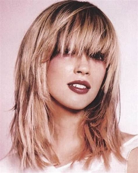 haircuts with bangs and choppy layers 12 long layered haircuts with bangs learn haircuts