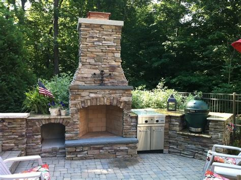 grand rapids fireplace outdoor kitchen and pool