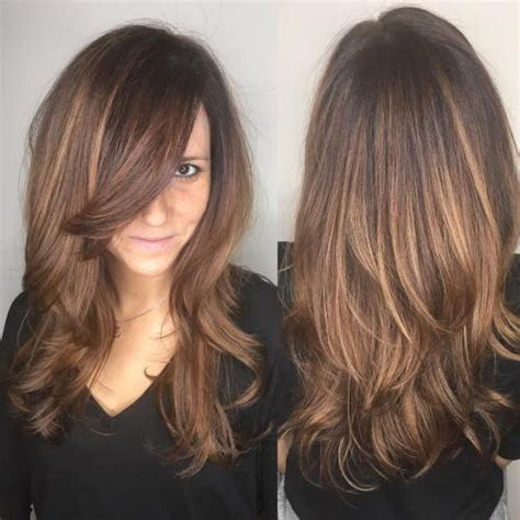 jumbo play with your hair cut on the side 50 cute long layered haircuts with bangs 2018