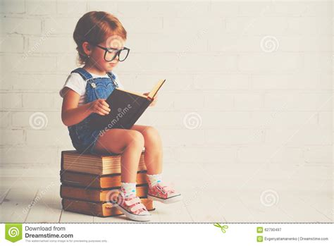 libro little guruji the childhood child little with glasses reading a books stock image image 62790497