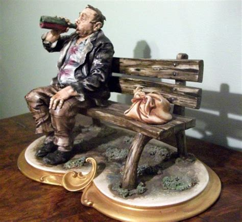 bench drinking capodimonte tr on bench drinking from bottle tr