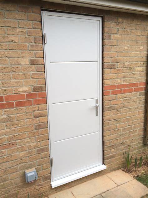 Garage Side Door by Driving The Bend