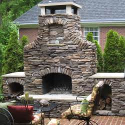 Outdoor Fireplace And Grill - a custom stone outdoor fireplace by select family leisure
