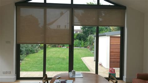 Roller Shades For Patio Doors Electric Roller Blinds Covering Bifold Patio Doors