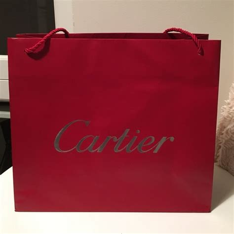 Cartier Paperbag M cartier authentic cartier shopping bag large from lulu s closet on poshmark