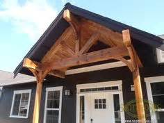 Beam X Front Of House by This Porch With It S Stained Exposed Beams Looks So Nice