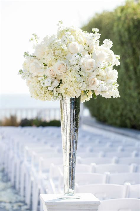 tall white rose and hydrangea centerpiece in a silver