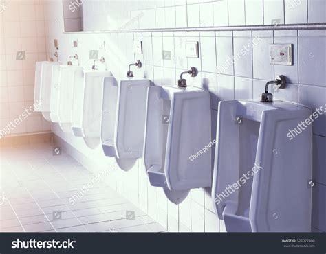 men s bathroom design closeup white urinals in men s bathroom design of white