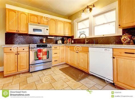 Light tones wood kitchen with brick backsplash design royalty free stock photos image 37267678