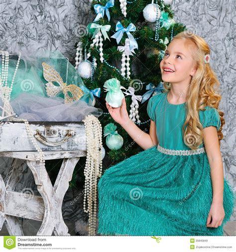 beautiful blonde girl  christmas tree royalty  stock images image