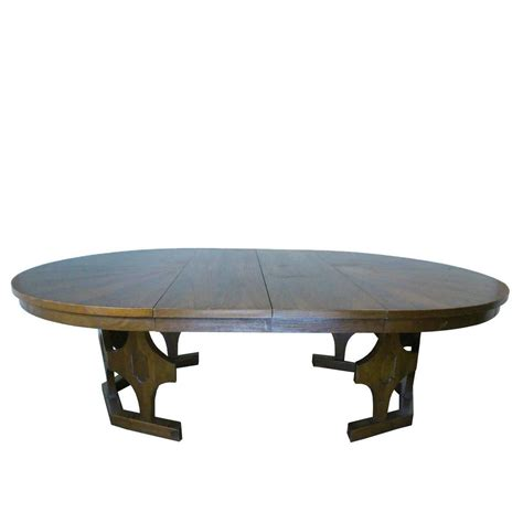 expandable round dining table 1960s mid century expandable round walnut dining table at