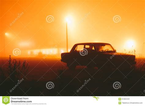 car in the fog stock photo image 61084444