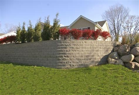 retaining wall to level backyard landscape walls dayton cincinnati schneider s lawn care landscaping