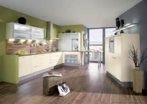 Green kitchens with white cabinets and walls