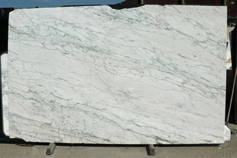 Marble And Granite Slabs Carrara Vs Calacatta Marble What Is The Difference