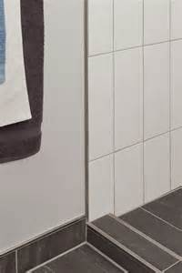 Quadec square shaped profile and corners applied to tile edges of the