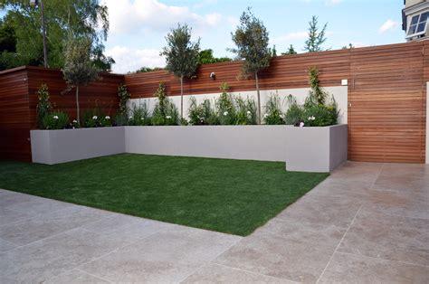 Small Garden Patio by Modern Garden Design Fulham Chelsea Clapham Battersea