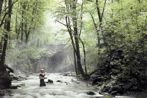 1920x1200 fishing in the river desktop pc and mac wallpaper