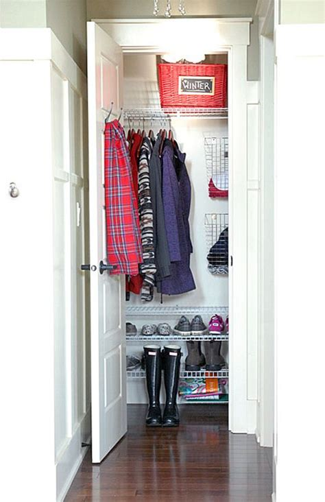 how to organize a closet with sliding doors organized coat closet i like the wire shoe shelves top shelf basket wire baskets for mittens