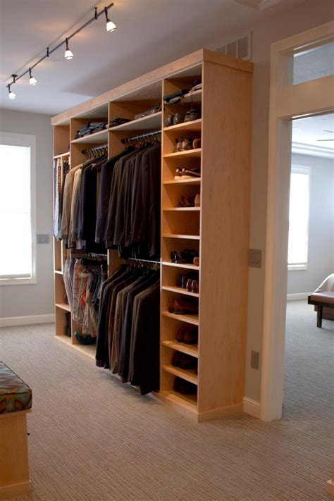 mens walk in closet 16 stylish men s walk in closet ideas hgtv