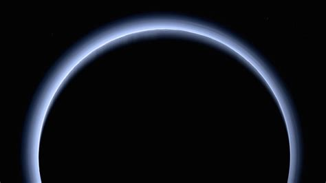 new images of pluto new horizons probe captures pluto s atmosphere in stunning