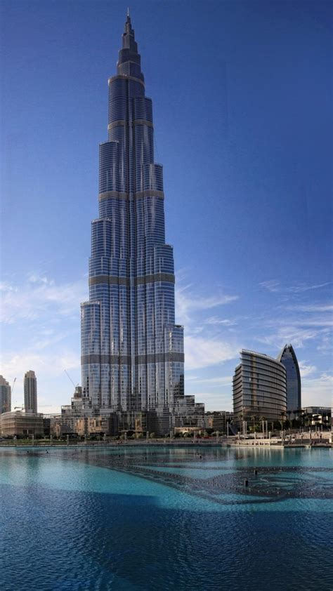 wallpaper khalifa tower dubai sky clouds water pool