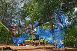 treetop net troline park opens 30 feet above the ground