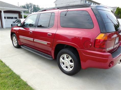 purchase used gmc envoy 4x4 slt third row seating in rocky