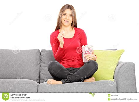 sofa for watching tv young beautiful woman on a sofa watching tv and eating