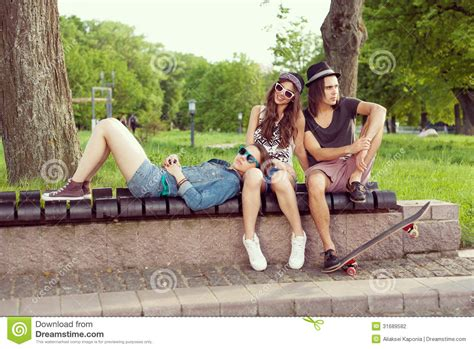 park bench people sitting on park bench stock photography image 31689582