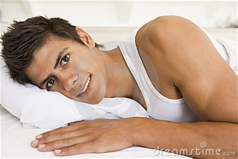 lying in bed smiling royalty free stock photography