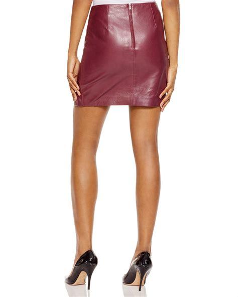 n nicholas crossover leather mini skirt in purple