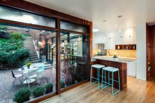 homes with interior courtyards new kitchen addition opens up to below grade