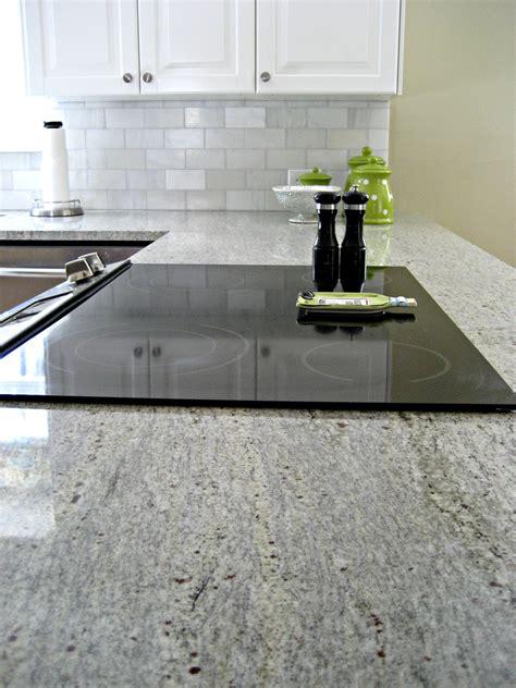 foil kitchen cabinet doors carrara mosaic backsplash granite grouse interior kashmir white granite kitchen transitional with glass