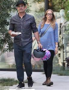 modern family ty burrell grins delight carries adopted daughters daily