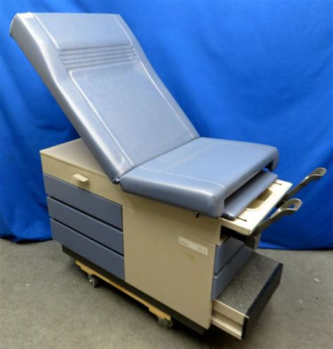 midmark ritter 104 medical exam table with stirrups blue