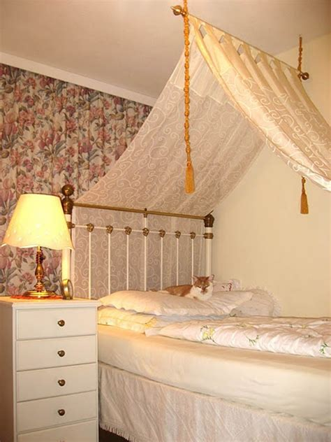 white and gold canopy bed with curtains vine dine king
