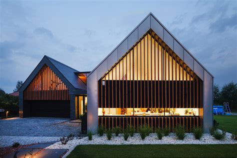 two barns house two barns home with a pitched roof in poland by rsplus