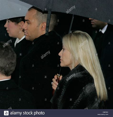 Calum Best in front of his mother Angie Best at George